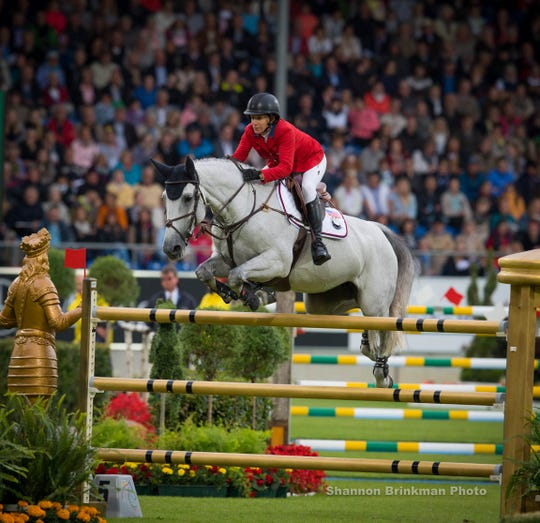Two-time Olympian Laura Kraut and her horse Zeremonie, compete in the Mercedes-Benz Nations Cup last year in Germany. Kraut will represent the United States on the jumping team at the FEI World Equestrian Games in Tryon.