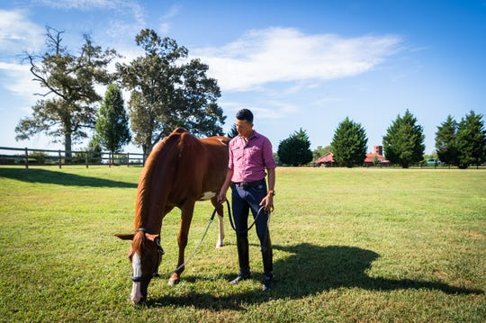 Julio Mendoza, an FEI International trainer and instructor, with one of his horses at his farm in Columbus, Friday, August 31, 2018. Mendoza will be competing in the Dressage competition at the World Equestrian Games at the Tryon International Equestrian Center.