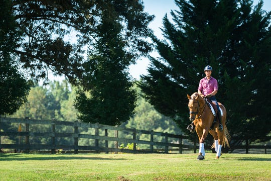 Julio Mendoza, an FEI International trainer and instructor, rides one of his horses, Heroic Time at his farm in Columbus, Friday, August 31, 2018. Mendoza will be competing in the Dressage competition at the World Equestrian Games at the Tryon International Equestrian Center.