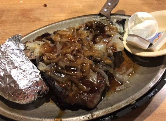 The XXL Porterhouse at Bill's Steak House is one of the biggest steaks in you can get in the area at 32 ounces and comes with toppings like grilled onions and a bourbon glaze.