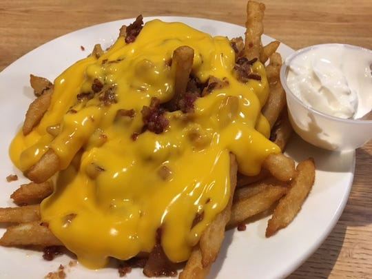 The Loaded Brew City Fries are on the appetizer menu at Bill's Steak House in Bronson