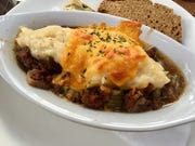 The Cottage Pie at Cottage Irish Pub was seasoned the British-Irish way, just savory enough, not watery or oily, and coated with good mash crowned with melted cheese.