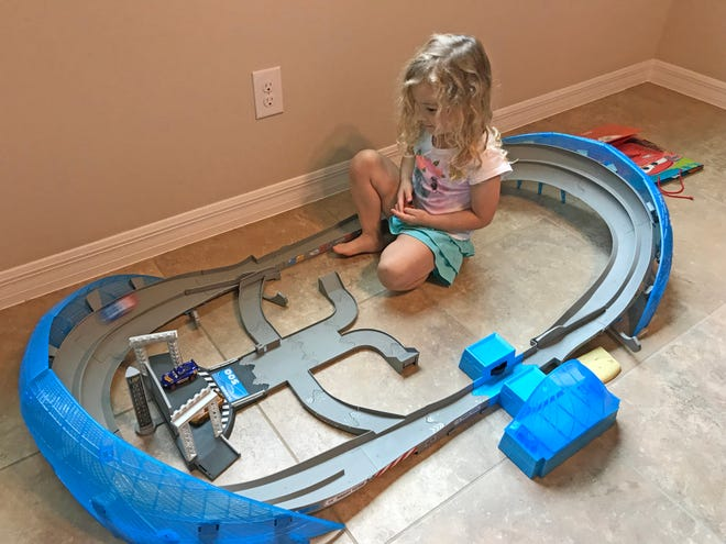 Isabella still loves to play with the race track she got for Christmas last year. Now that it's September, this is the time to start looking for presents for this year.