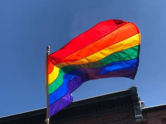 Pride flags adorned Burlington's Church Street Market Place on Tuesday, Sept. 4, 2018.