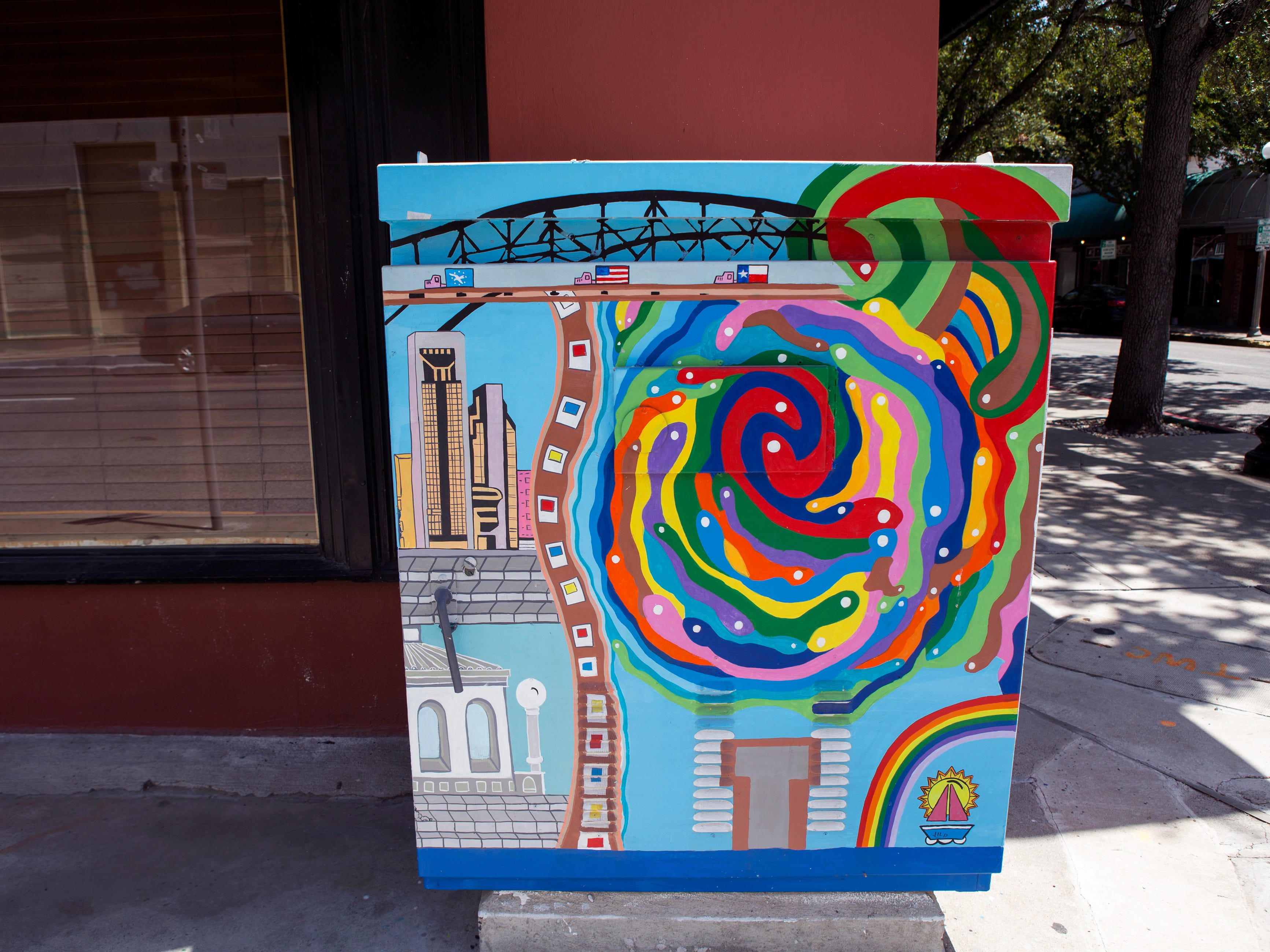 A painted utility box in downtown Corpus Christi is located near the corner of Peoples and N. Mesquite streets. The Downtown Management District began the process of having the boxes painted in 1997 with a program called Art Sparks. The program allowed students interested in art to paint the boxes over the summer under the supervision of a teacher and get paid for their work. In 2004, the district began using commissioned artists.