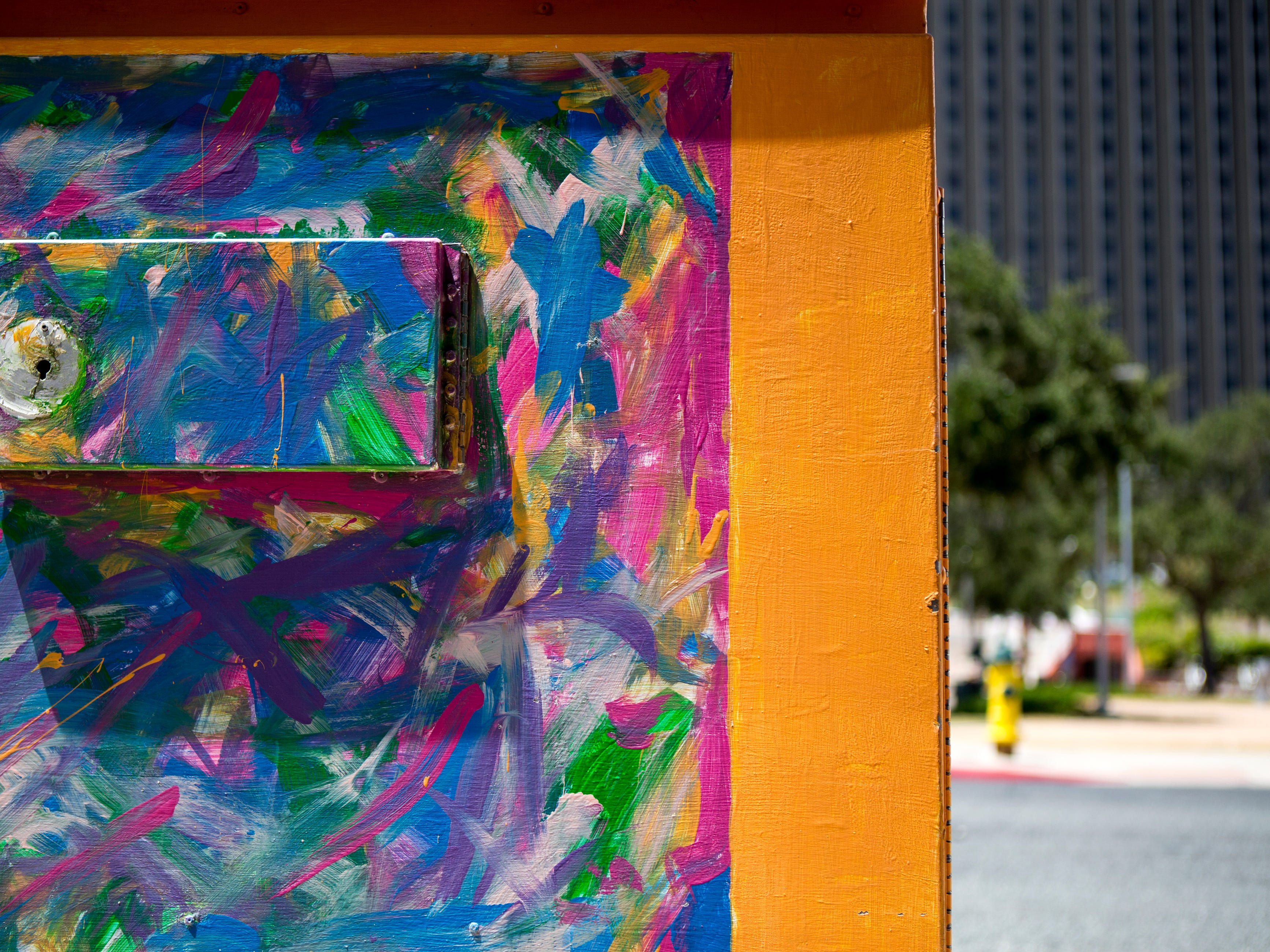 A painted utility box in downtown Corpus Christi is located near the corner of Schatzell and N. Mesquite streets. The Downtown Management District began the process of having the boxes painted in 1997 with a program called Art Sparks. The program allowed students interested in art to paint the boxes over the summer under the supervision of a teacher and get paid for their work. In 2004, the district began using commissioned artists.