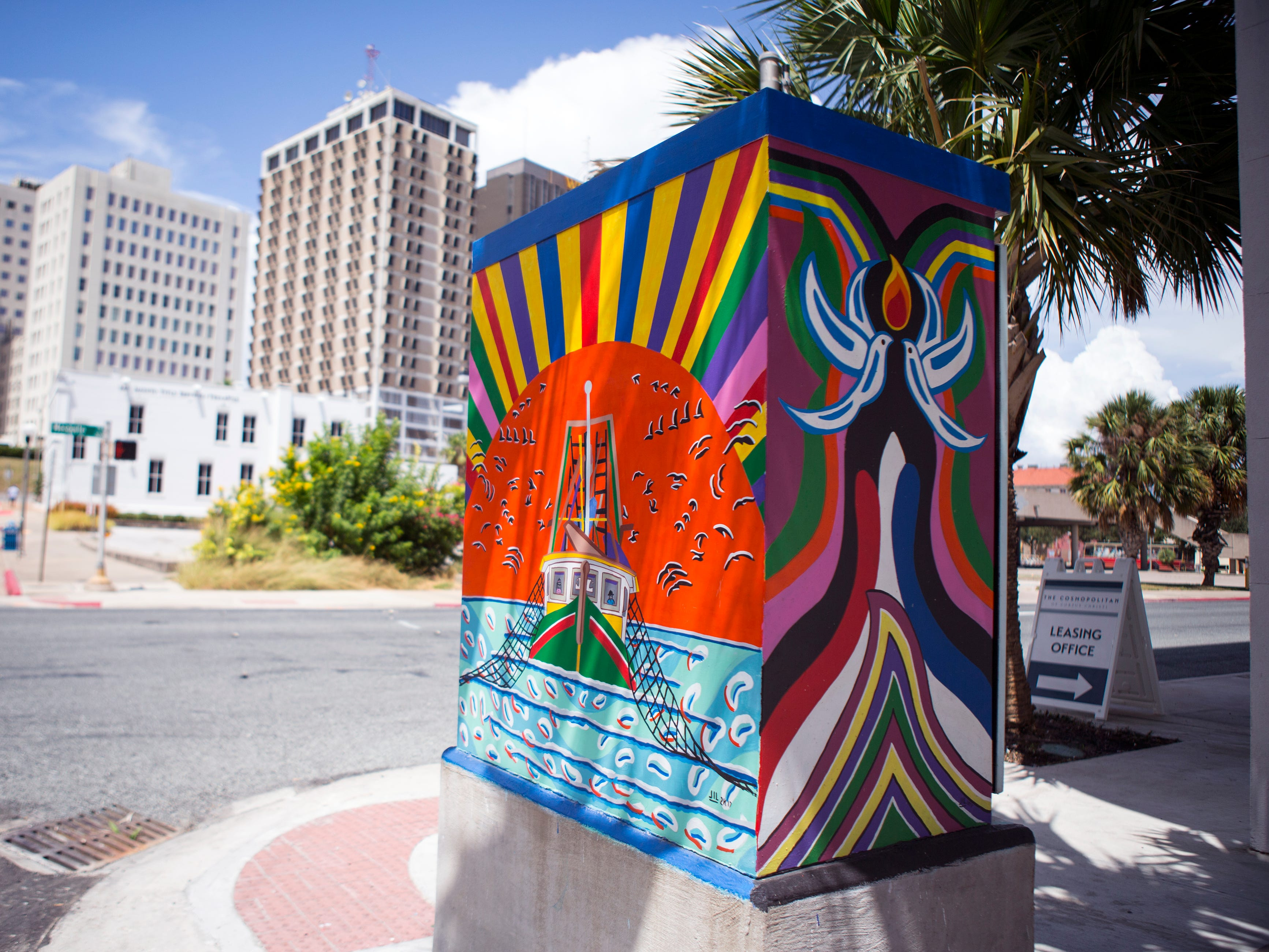 A painted utility box in downtown Corpus Christi is located near the corner of Lawrence and N. Mesquite streets. The Downtown Management District began the process of having the boxes painted in 1997 with a program called Art Sparks. The program allowed students interested in art to paint the boxes over the summer under the supervision of a teacher and get paid for their work. In 2004, the district began using commissioned artists.
