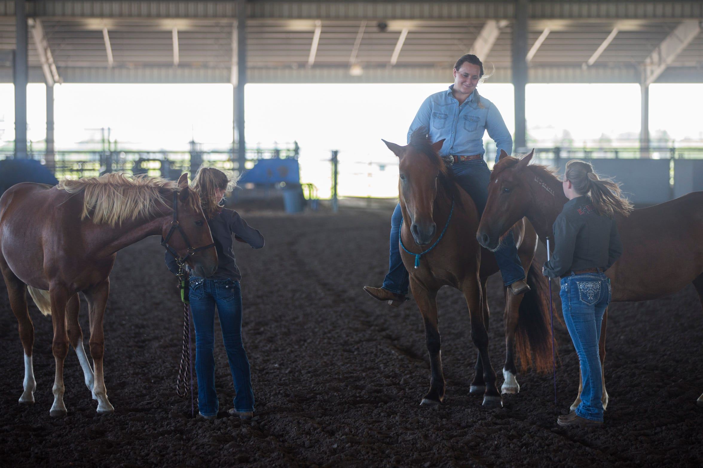 Claire Walsh, 19, works with her horses at the Robstown fairgrounds as she prepares for the Extreme Mustang Makeover competition in Forth Worth.