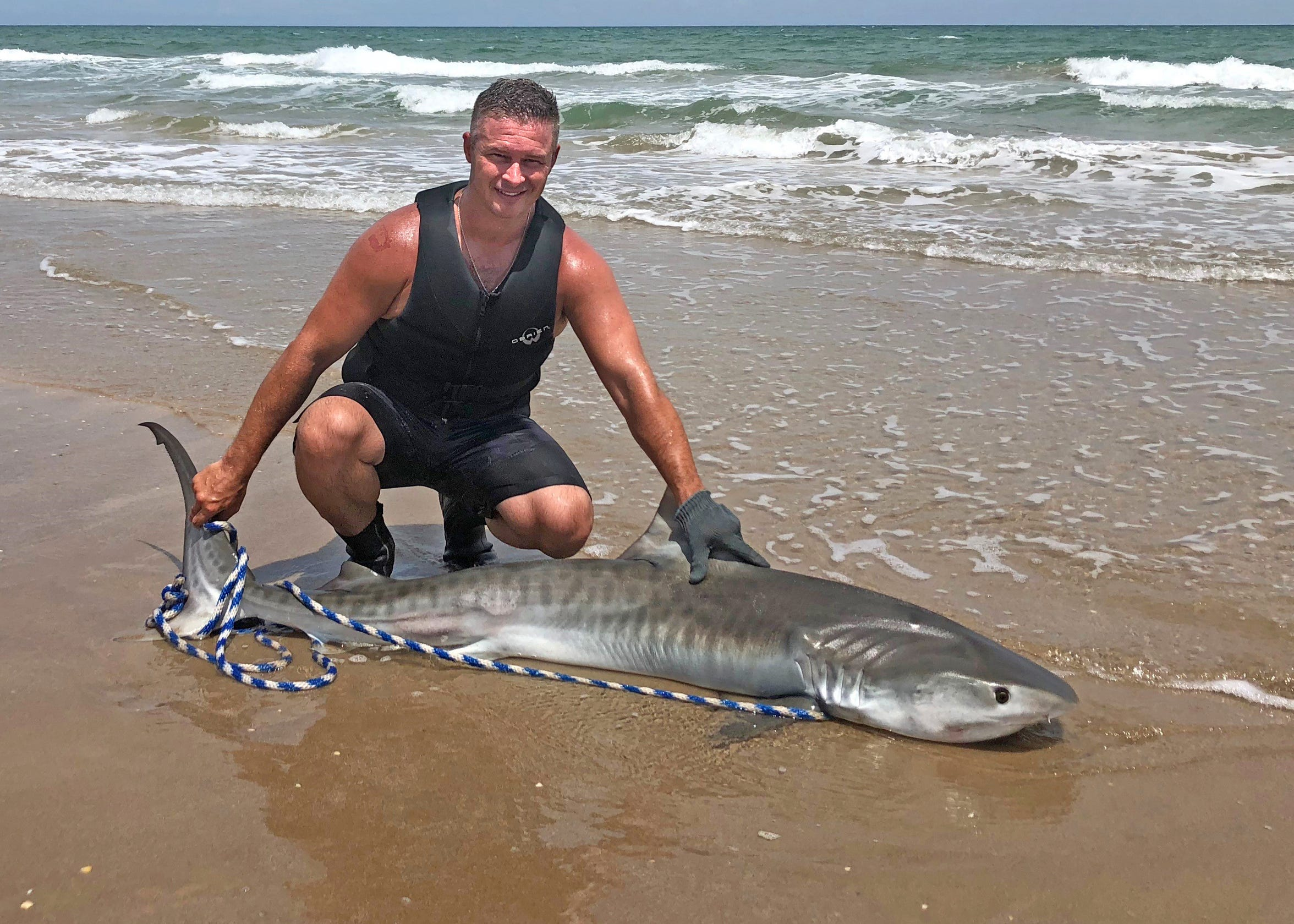 The first tiger shark Josh Rieder caught measured 7-foot. It was released.