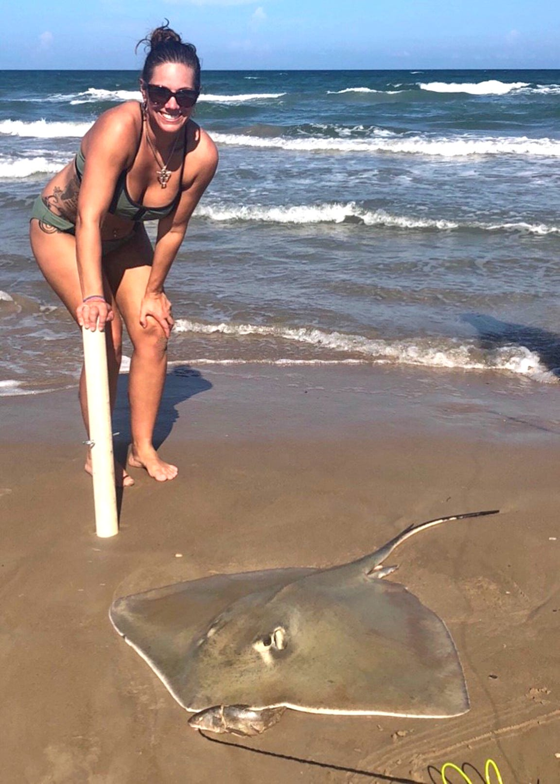 Amber Rieder, a mother of five kids, caught this stingray, which her husband Josh Rieder used as bait to catch two tiger sharks during Labor Day weekend.