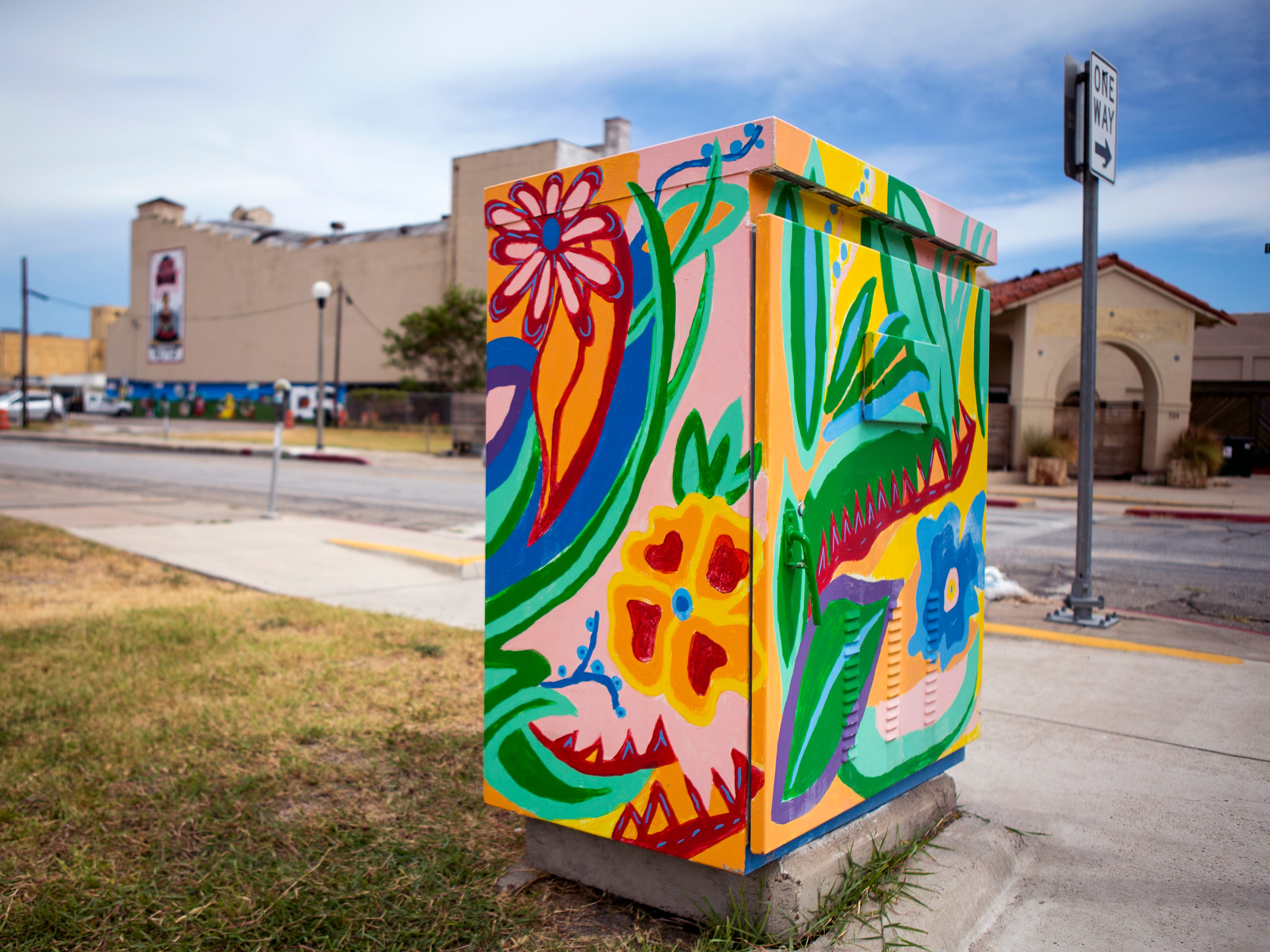 A painted utility box in downtown Corpus Christi is located near the corner of Taylor and N. Mesquite streets. The Downtown Management District began the process of having the boxes painted in 1997 with a program called Art Sparks. The program allowed students interested in art to paint the boxes over the summer under the supervision of a teacher and get paid for their work. In 2004, the district began using commissioned artists.