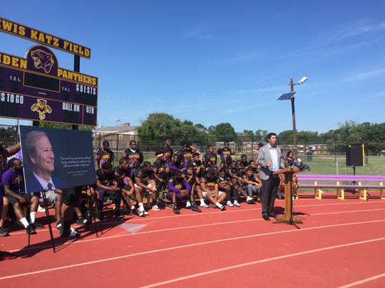 Drew Katz, son of the late Lewis Katz, speaks at the dedication of a new scoreboard at Camden High School.