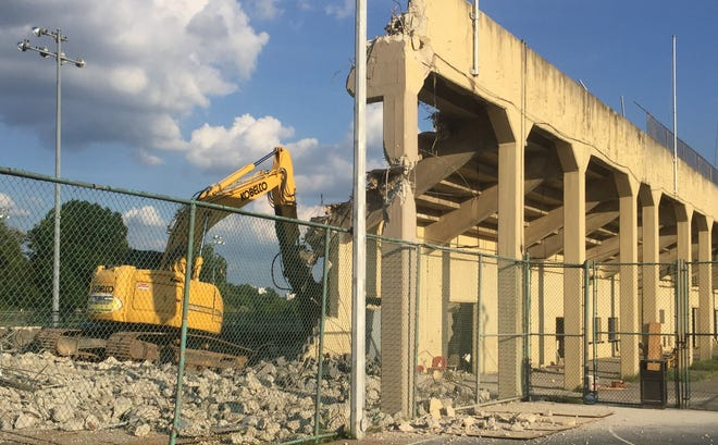 A demolition crew on Tuesday was razing the grandstand behind Collingswood High School.