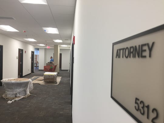 Workers are putting the final touches on office space for state agencies in a formerly sealed-off area of Camden City Hall