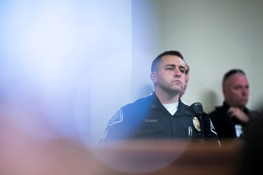 Police officers show up in support during a detention hearing for Juan Figueroa Tuesday, Sept. 4, 2018 at the Camden County Hall of Justice in Camden, N.J. Figueroa is accused of shooting two Camden County police detectives and will remain detained until trial.