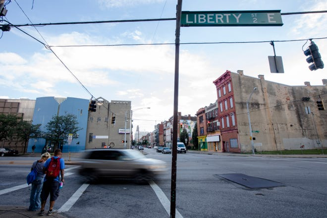 People cross Liberty Street at Vine Street in the Over-The-Rhine neighborhood of Cincinnati on Sept. 4. A long-discussed plan to narrow the street (by widening the sidewalks) was killed this summer, but may have new life.
