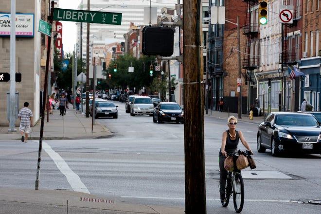 People cross Liberty Street at Vine Street in the Over-The-Rhine neighborhood of Cincinnati on Tuesday, Sept. 4, 2018.