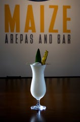 Pina Colada made with Bacardy Coconut Rum, Bacardi Pineapple Rum, Barcadi Black Rum, pineapple juice, coconut cream and lime served at Maize Arepas and Bar in Over-The-Rine on Aug. 24, 2018.