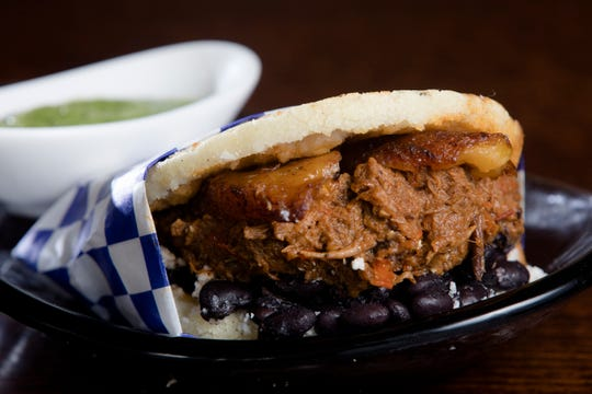 Pabellon made with juicy shredded beef, black beans, sweet plantain and quest fresco at Maize Arepas and Bar in Over-The-Rine on Aug. 24, 2018.
