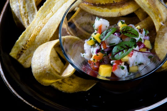 Ceviche Con Leche de Tigre made with red snapper, shrimp, lime juice, mango, cilantro, red onion and bell pepper, garnished with Serrano rings and mariquitas at Maize Arepas and Bar in Over-The-Rine on Aug. 24, 2018.