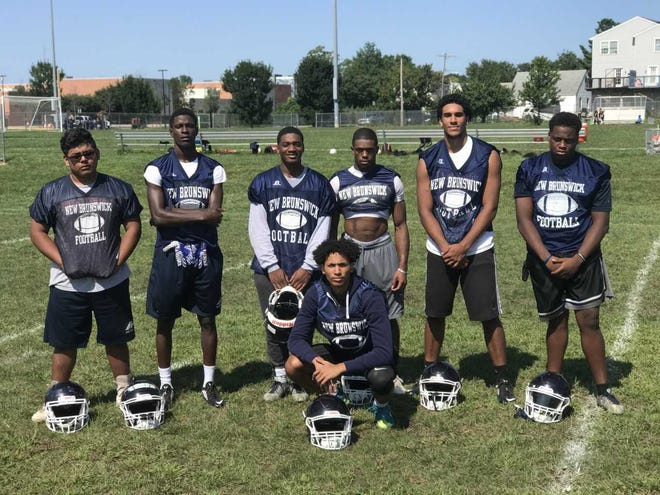 New Brunswick players (up front) Michael Bryant. (From left to right) Axel Salvador, Ahmad Harrison, Ahyan Brown-Miller, Dylan Johnson, Kerandy Gomez, Al-Quan Brown-Taylor