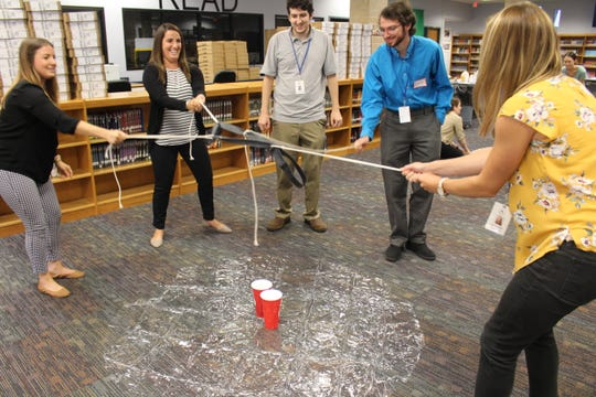 Left to right: Alexandra Pranzo, Woodland Guidance Counselor, Ashley Allegra, Central School Paraprofessional, Christian Paolella, District Computer Technician, Richard Bardy, WMS Paraprofessional and Lauren Farrell, Central School Grade 5 Teacher, successfully working together during the Toxic Popcorn activity.