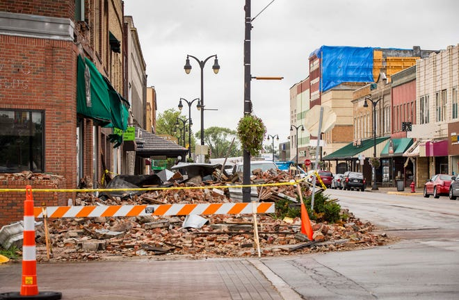 Restoration and demolition continues on Marshalltown businesses on the town square Monday, Aug. 20, 2018, in Marshalltown, Iowa.