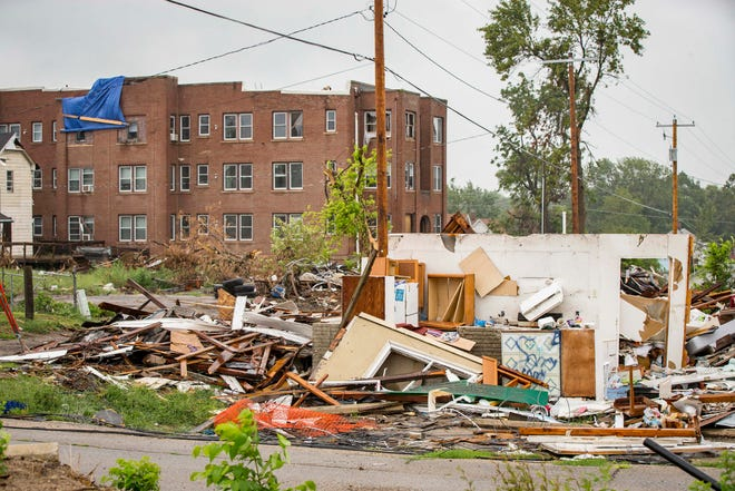 Restoration continues in Marshalltown on homes just north of the downtown Monday, Aug. 20, 2018. A preliminary count showed that 89 homes were destroyed and 525 suffered major damage, though city leaders are working on a more updated inventory.