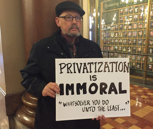 Eric Stimson, protesting the state's plans to privatize Medicaid health care for low-income and disabled Iowans, at the Iowa Capitol in February 2016.
