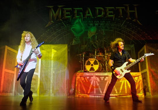 Megadeth frontman Dave Mustaine (L) and bassist David Ellefson perform during the Jagermeister Fall Music Tour at The Pearl concert theater at the Palms Casino Resort October 20, 2010 in Las Vegas, Nevada.