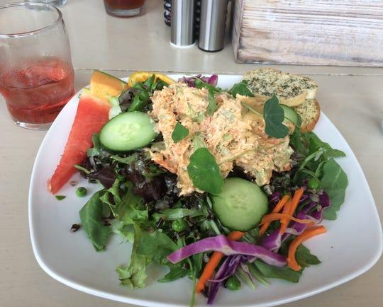 A salmon salad with an Izze sparkling juice at Trellis Cafe.