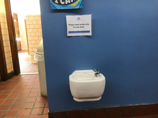 A sign on the second floor of Gardner Elementary School in Detroit warns students not to drink the water. A water cooler was located across the hallway.