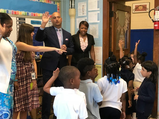 Detroit Superintendent Nikolai Vitti and Angelique Peterson-Mayberry, vice president of the Detroit Board of Education, talk to students inside a classroom at Gardner Elementary School on the first day of school Sept. 4, 2018.