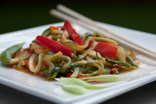 Zoodle Snap Pea Stir Fry for healthy table and In Good taste, photographed at Great Lakes Culinary Center in Southfield, Tuesday, August 1, 2017.