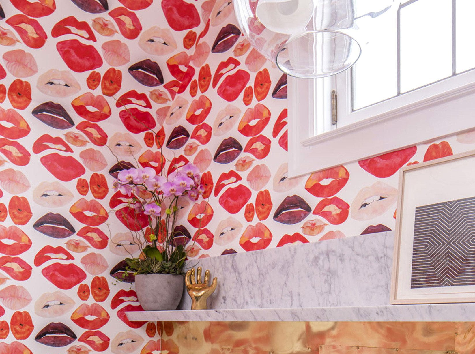 A whimsical montage of lips from artist George Venson for Voutsa brightened a powder room for the San Francisco Decorator Showcase last year, on the walls and all the way up the ceiling.