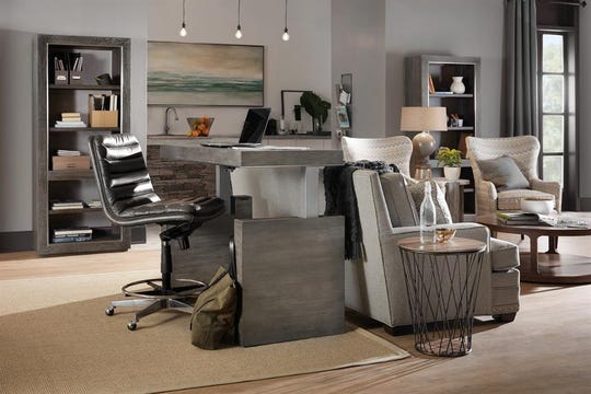 Wood furniture with gray finishes and undertones are popular for home offices, as are fabrics in geometric patterns.