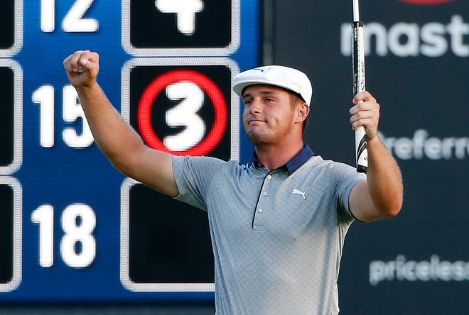 Bryson DeChambeau reacts after putting out on the 18th hole during the final round of the Dell Technologies Championship on Monday.
