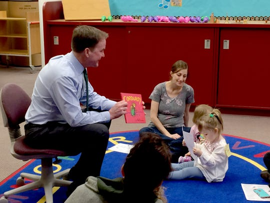 """Before announcing his plan for boosting literacy in Michigan Thursday, state Attorney General and Republican gubernatorial candidate Bill Schuette read a group of children at the Livonia Civic Center Library the story of """"Corduroy"""" in March, 2018."""