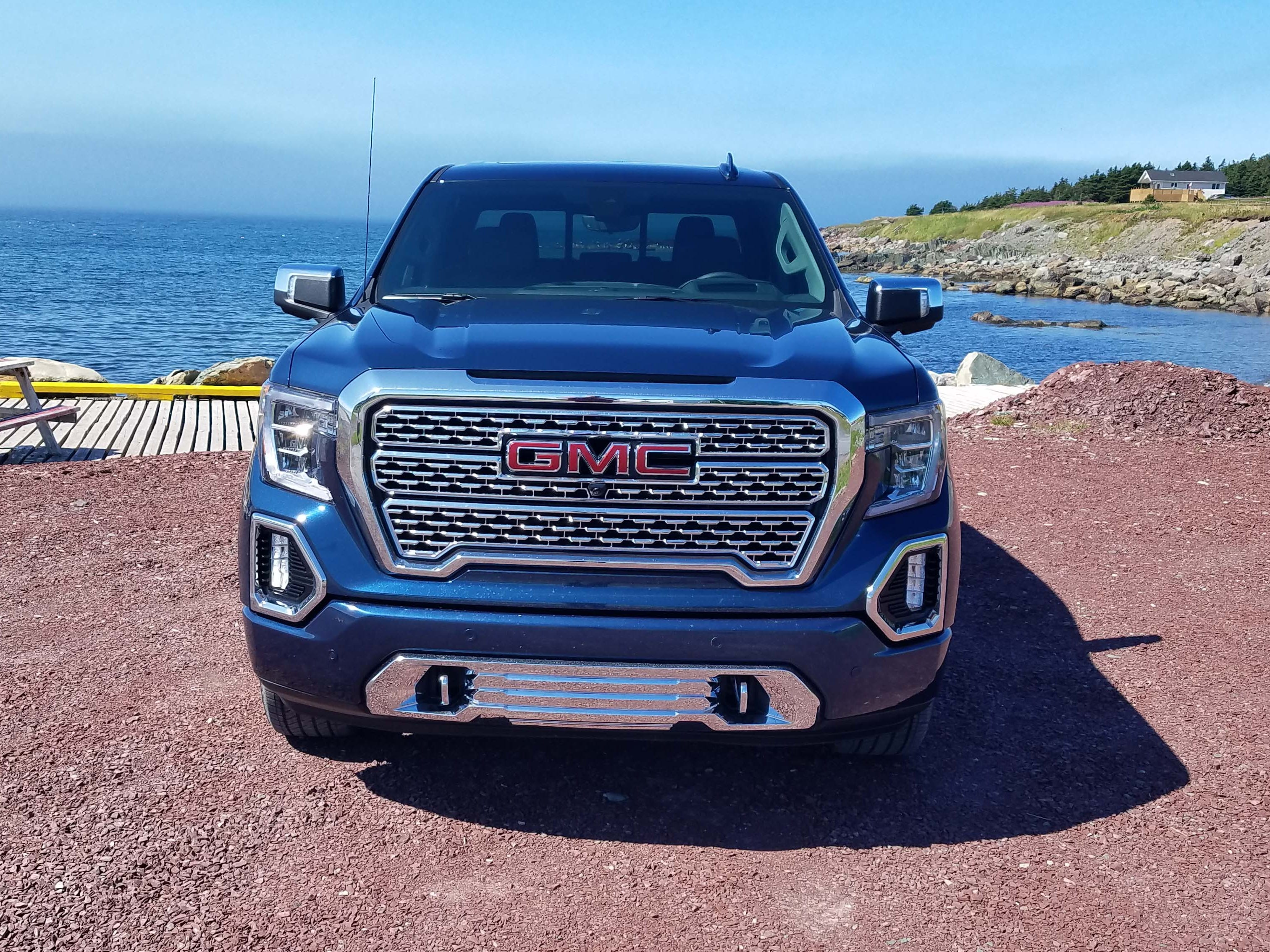 Chrome, please. The scupted grille says GMC Sierra, a signature of the premium brand.