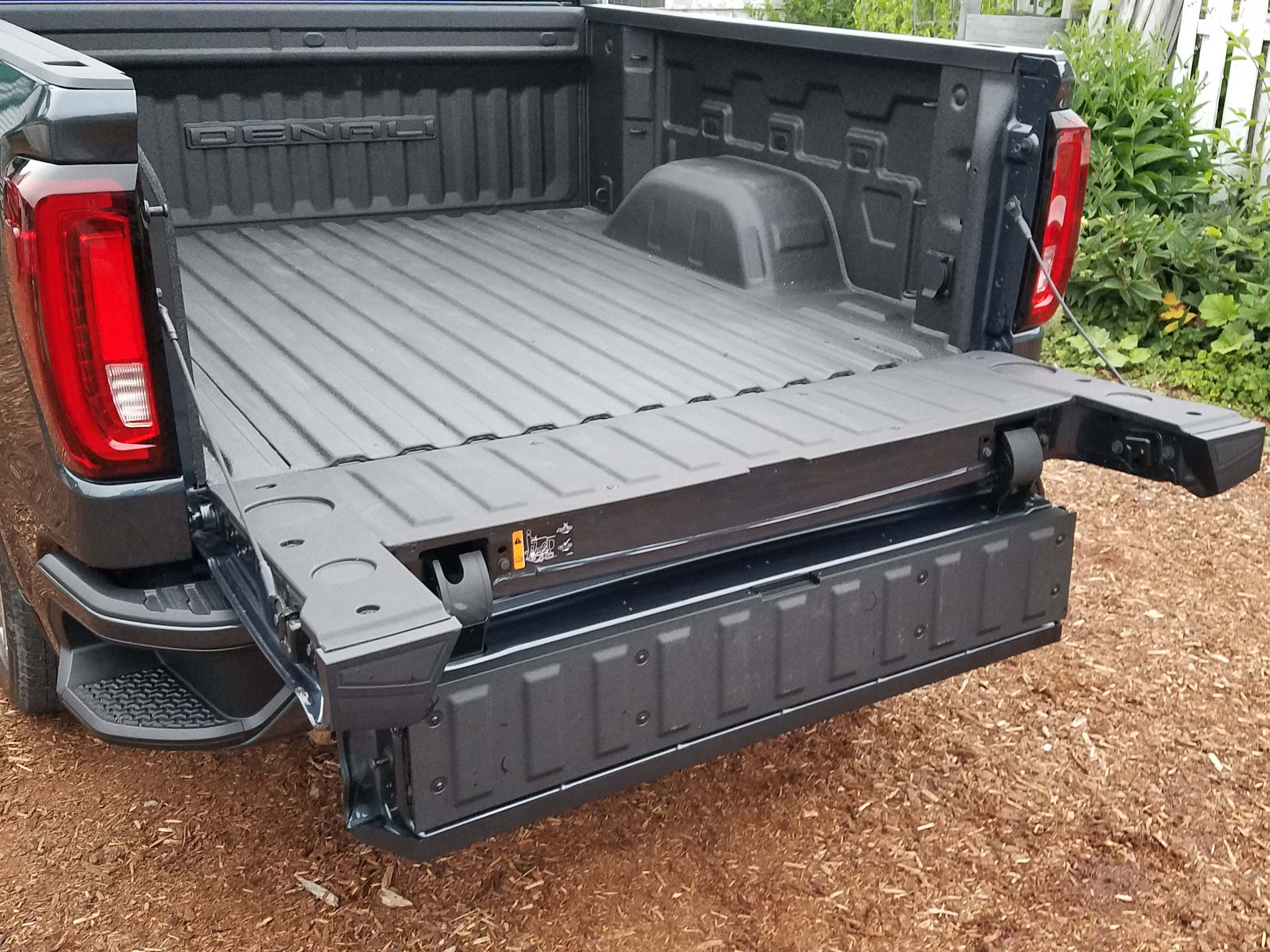 """GMC Sierra MultiPro tailgate, Step 5: With the full gate down, drop the inner gate, creating a sort of """"walk-in desk."""""""