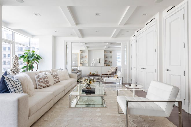 A four-seat sofa adds a sense of drama in this long, narrow living room.