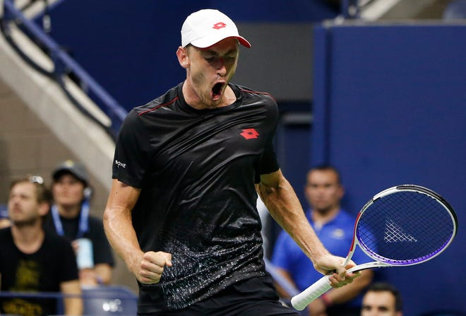 John Millman reacts after winning a point against Roger Federer during the fourth round of the U.S. Open.