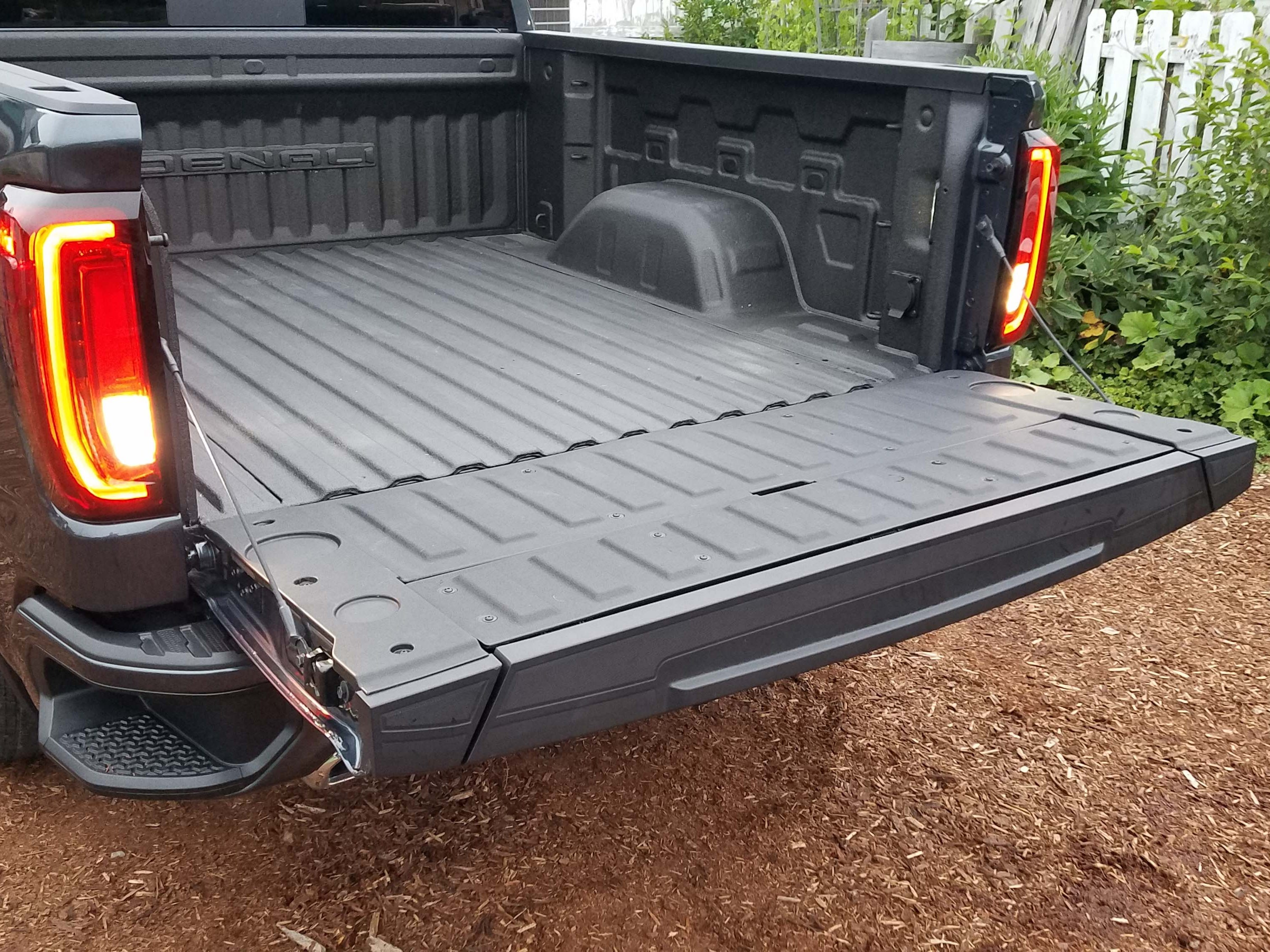 GMC Sierra MultiPro tailgate, Step 3: The full gate drops slowly on ropes, opening like a standard pickup (Sierra leaves the new, auto-close trick to Silverado.)