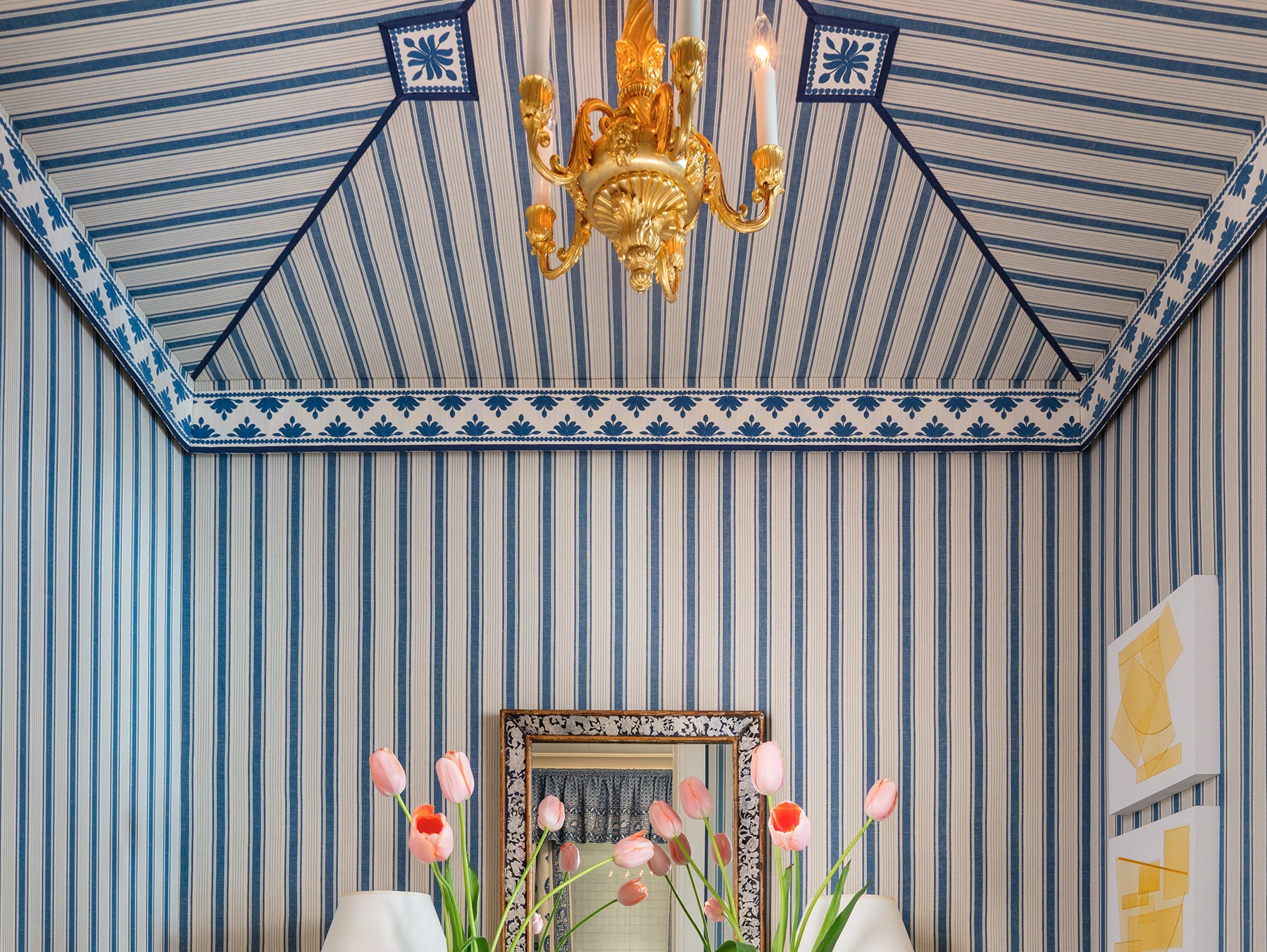 """Mark D. Sikes cocooned a small vestibule at the Kips Bay Show House in Schumacher's Ojai Stripe in Prussian blue, """"tenting"""" the ceiling in the same pattern. He trimmed it in French grosgrain ribbon from Samuel and Sons."""