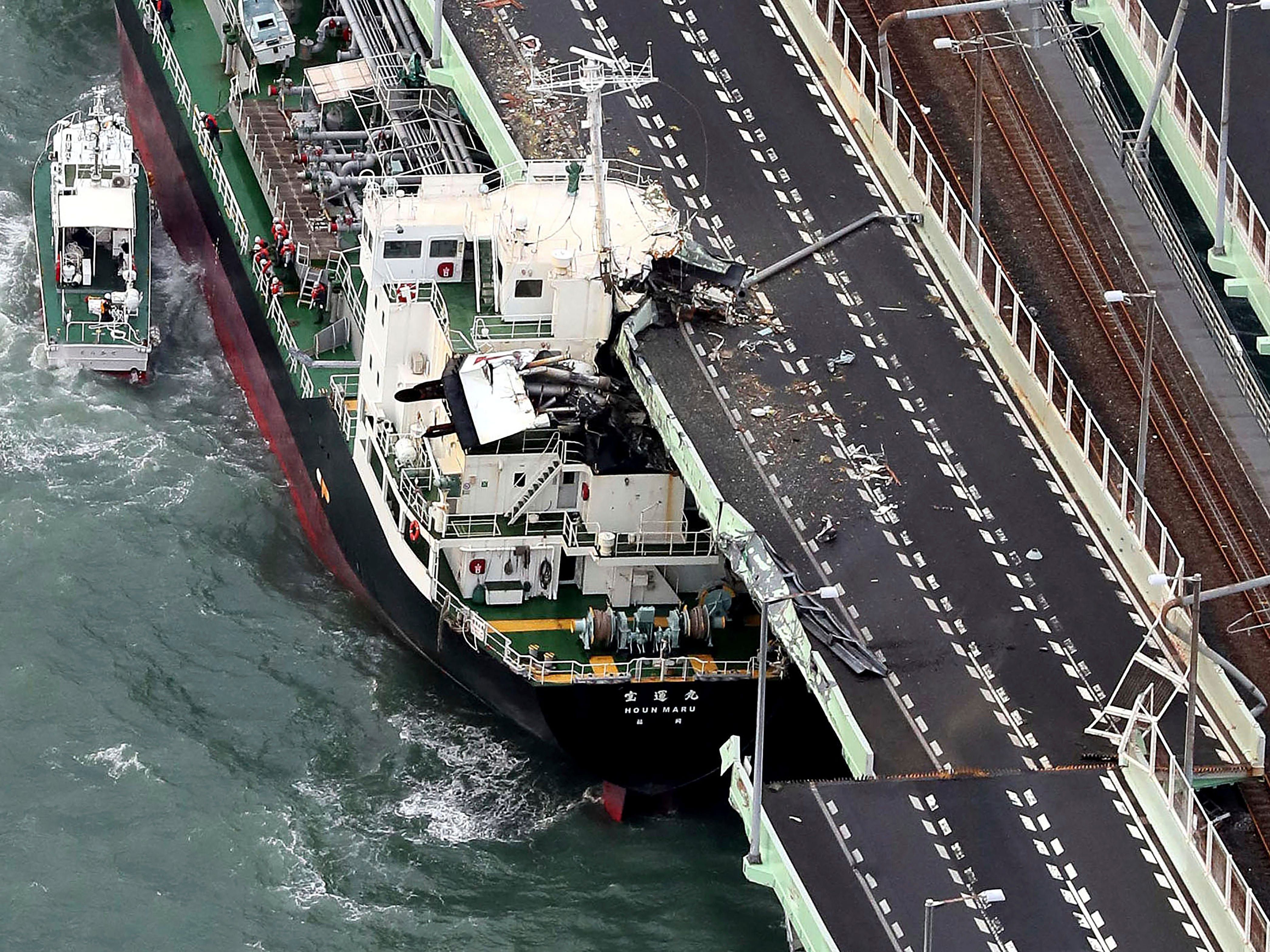 A tanker is seen after it slammed into the side of a bridge connecting the airport to the mainland, damaging part of the bridge and the vessel in Osaka, western Japan, Tuesday, Sept. 4, 2018.