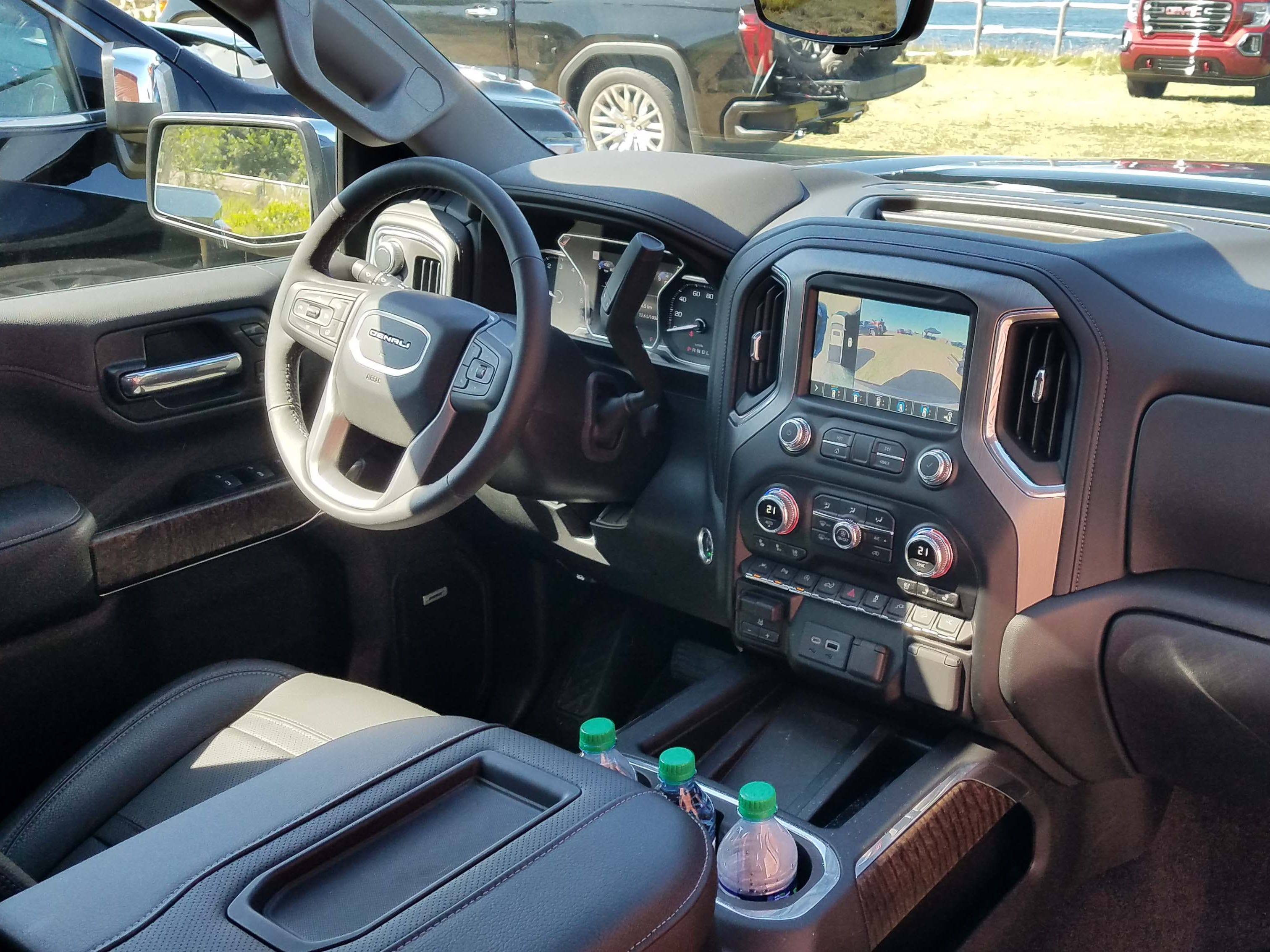 The interior of the 2019 GMC Sierra Denali is not as posh as offerings from upscale Ford F-150s and RAM 1500, but  its wood-and-leather trimmings are plenty nice, while ergonomics are excellent.