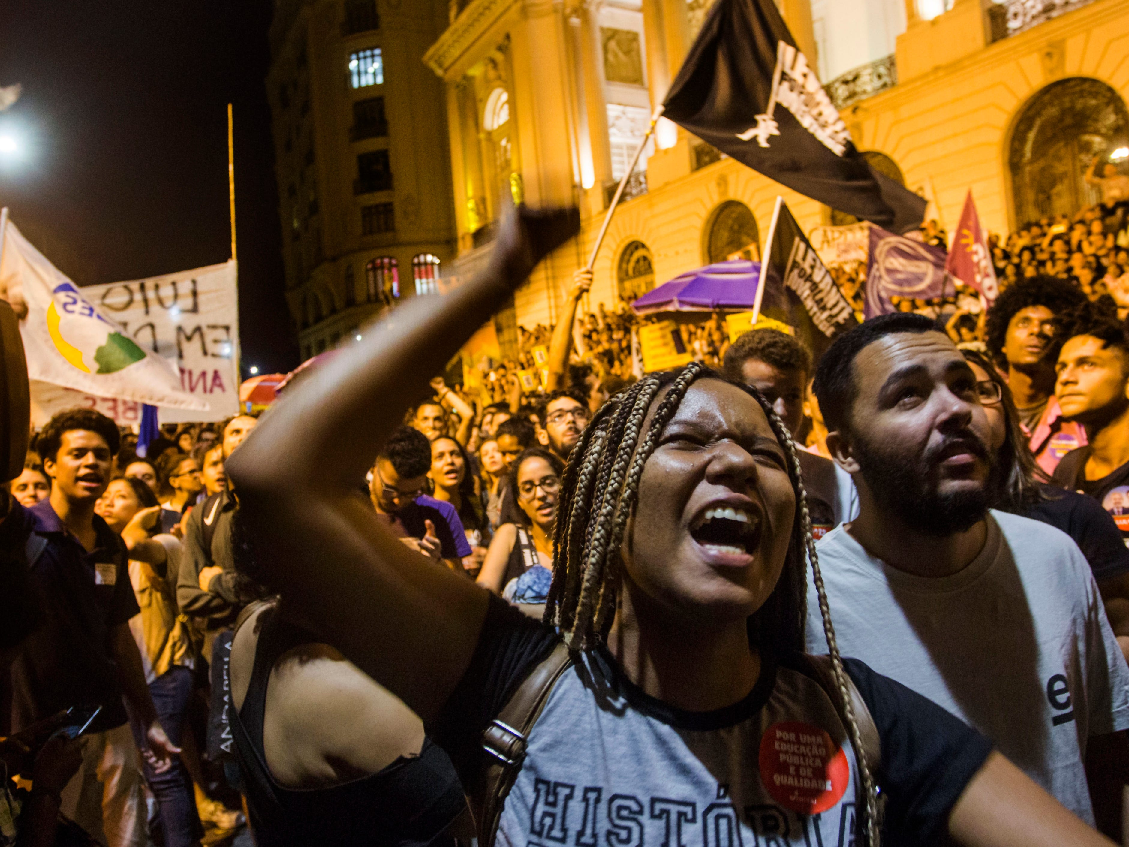 A woman shouts slogans during a protest against the Brazilian government on September 3, 2018, in Rio de Janeiro following a massive fire that ripped through Rio de Janeiro's treasured National Museum.