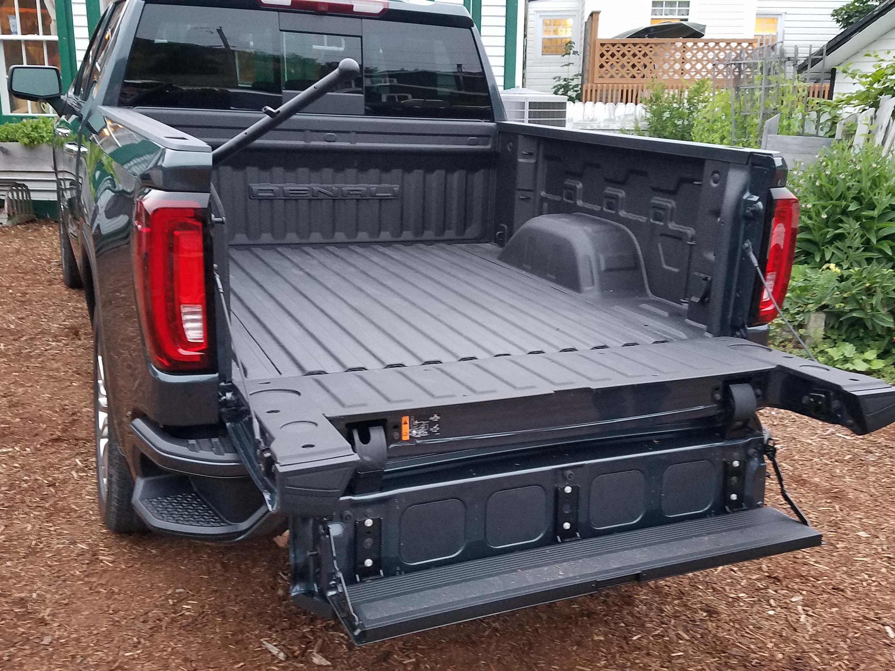 GMC Sierra MultiPro tailgate, Step 6: With the full gate and inner gate down, the load-stop shelf now acts as a step, creating a two-step staircase into the bed. GMC/Chevy were already innovators in this space with their corner step,  but the staircase makes easy bed entry when carrying big items. Say goodbye to hiking your knee up onto the tailgate to get in the bed.