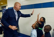 DPSCD Superintendent Nikolai Vitti high-fives Caimile Moreland, 5, during his visit at Schulze Elementary School on the first day of school, Sept. 4, 2018.