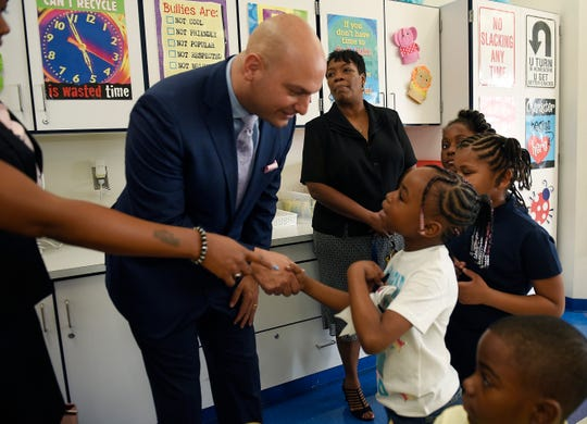 FILE -- Da' Carie Redes, 7, and her fellow second grader classmates greet Superintendent Nikolai Vitti during his visit to their classroom Tuesday morning.  DPSCD Superintendent Nikolai Vitti visited Schulze Elementary School to greet students and staff on the first day of school Tuesday, September 4, 2018 in Detroit.